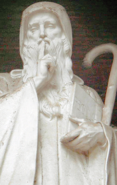 San Benedetto, che invita il visitatore al silenzio. Abbazia delle Tre Fontane, Roma. Foto Orlando Zambello